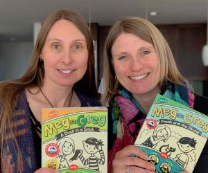 Rowena Rae and Elspeth Rae holding books from the Meg and Greg series